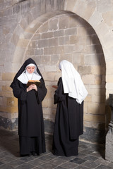 Fototapeta Two nuns in an old convent