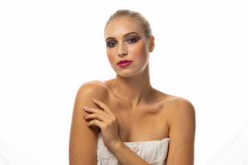 Young seductive blonde woman with stylish make-up