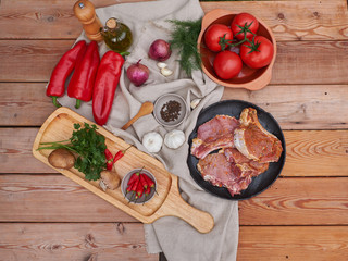 meat in a clay plate, tomatoes and pepper. country style