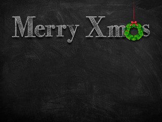 3d illustration rendering of chalk Merry Christmas wishes on blackboard with green garland decoration