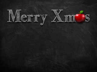 3d illustration rendering of chalk Merry Christmas wishes on blackboard with red apple decoration