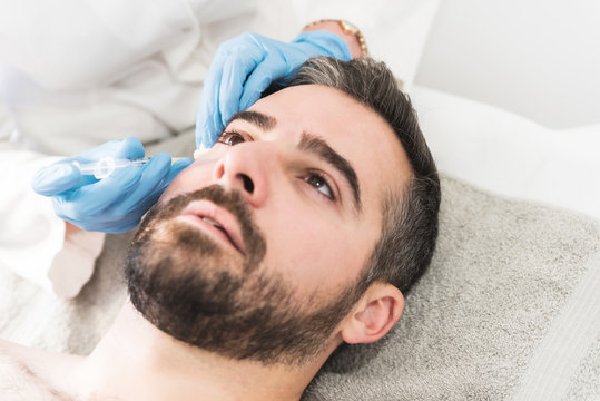 Man on face mesotherapy at clinic