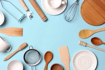 different kitchenware  on a colored background top view. Cooking appliances.