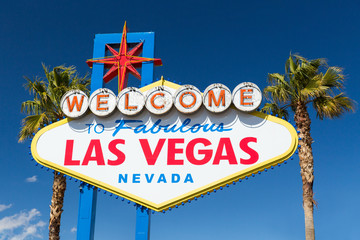Foto op Canvas Las Vegas landmarks concept - welcome to fabulous las vegas sign and palm trees over blue sky in united states of america
