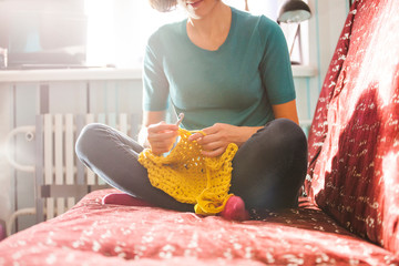 Woman knits crochet.