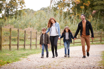 Family On Autumn Walk In Countryside Together Wall mural