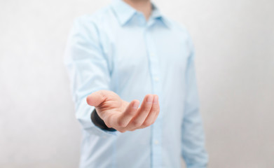 Man with open hand. Holding, giving, showing concept.