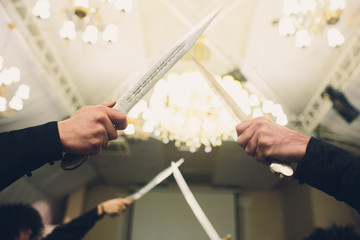 wedding tradition of Georgia, men play the game with knives.