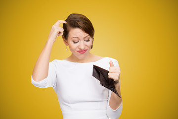 Confused woman having empty wallet
