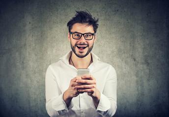 Expressive happy man using phone