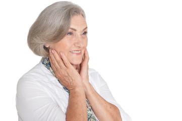 Portrait of beautiful senior woman on white background