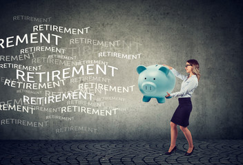 business woman attracting retirement funds with magnet piggy bank