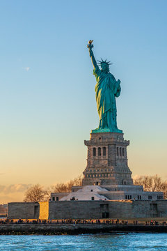 Statue of liberty vertical during sunset in New York City, NY, USA