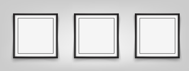 Three square black frames hanging on a gray background. Vector illustration