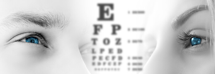 male and female eyes close up on white isolated background. Vision test table