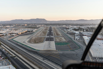 Wall Murals Air photo Late afternoon aerial view of airport runway approach in the San Fernando Valley area of Southern California.