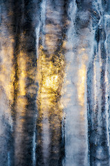 beautiful ice texture lit from behind. ice and sun, cold and warm, winter and spring resistance concept