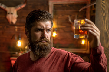 Barman with whisky or brandy. Bearded man drinking alcohol. Drink and celebration party concept. Degustation and tasting.