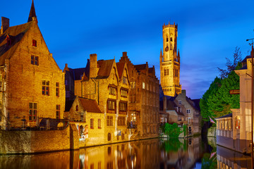 Photo sur Toile Bruges Bruges, Belgium. Evening sunset with blue sky. Water channels