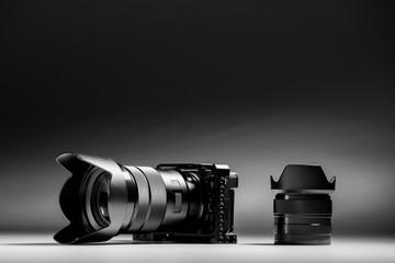 Mirror less digital camera end lens on a black background