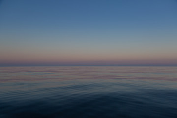Calm seascape in blue and purple colors