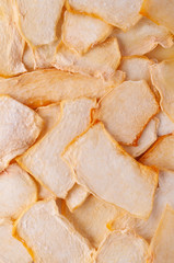 Dried melon slices (chips) background.