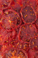 Dried tomato slices (chips) background.