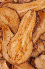 Dried pear slices (chips) background.