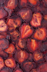 Dried strawberry slices (chips) background.
