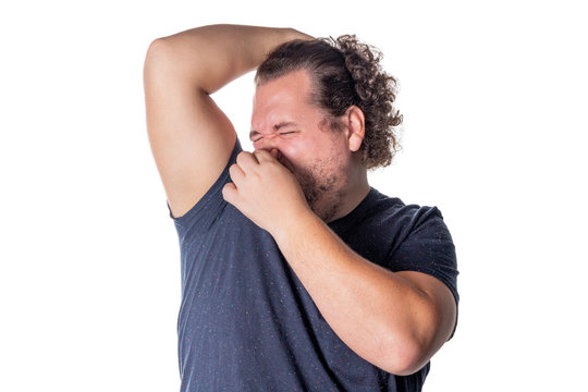 Fat man holds or pinches his nose shut because of a stinky smell or odor. Isolated on a white background