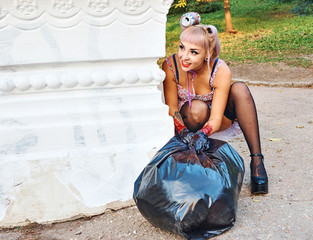 Sexy blonde in stockings with a big black bag