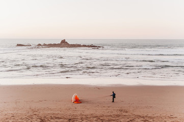 Paragliding on the beach in the legzira of Morocco