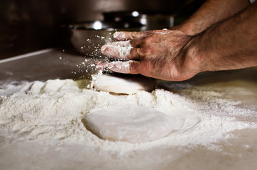 Cropped image of hand making pizza bread