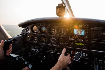 Aircraft cockpit at sunset