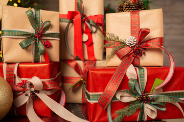 Marry Christmas and happy New Year celebration. Family gifts boxes and design home decor.