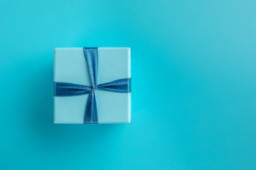blue gift box on blue background