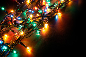 Christmas background with lights and free text space. Christmas lights border. Glowing colorful...