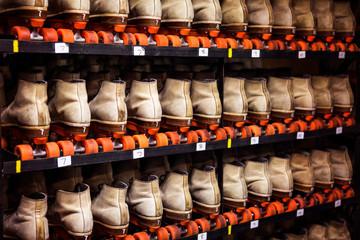 Roller skates on shelves at roller rink