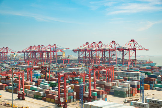 Shanghai port container freight terminal. Shanghai became the world's largest container port and plays a dominant role in the trade between East and West.