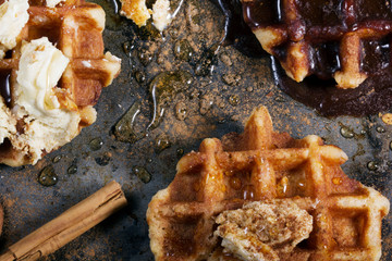 Overhead view of waffle with cinnamon on table