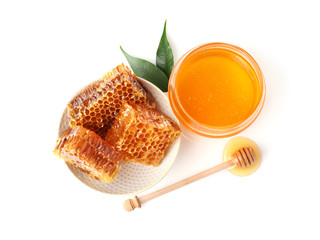 Composition with jar of honey isolated on white, top view