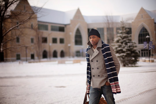 Portrait of confident man walking on street in cold temperature