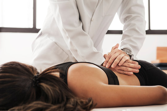 Woman receiving osteopathy treatment at clinic