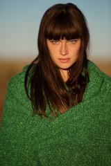 Portrait of woman wrapped in blanket