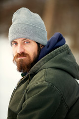 Portrait of serious man in warm clothing