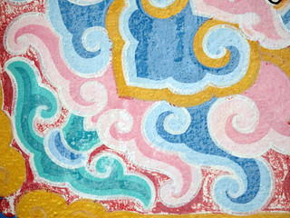 Elements from a pattern painted on an old Buddhist temple wall makes a pretty pale colored patterned background