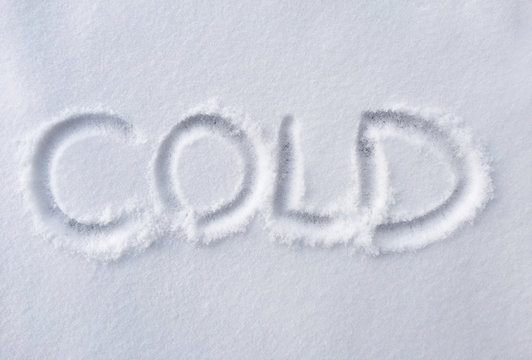 hand written COLD on fresh snow