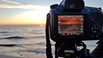 camera photograph sunset