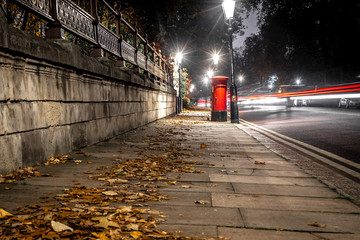 Classic red post box in London in the night