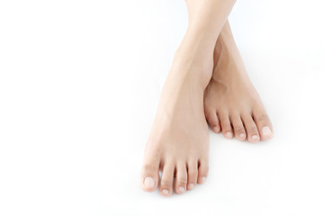 Beautiful female legs and feet on a white background.Concept beauty and hydration of the skin. Wall mural